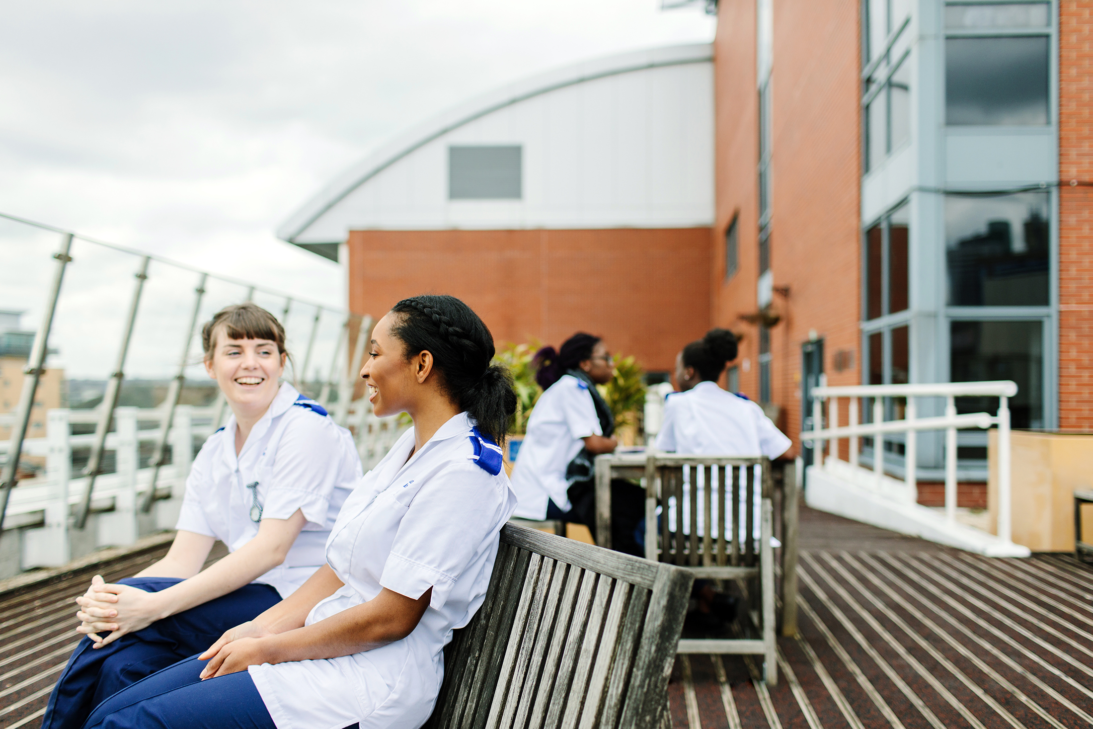 Two female student nurses sitting on a bench. Photograph by Mark Webster