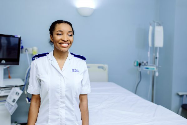 A portrait of a female student nurse on a ward. 'Copyright Mark Webster'