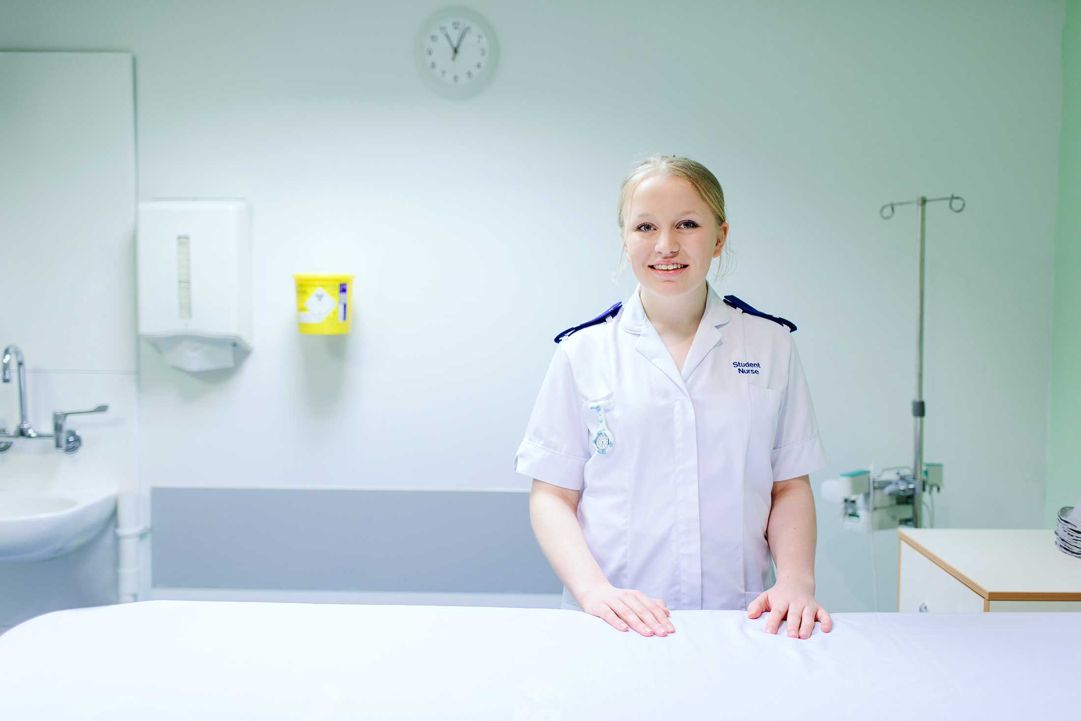 A portrait of a female student nurse on a ward. 'Copyright Mark Webster'