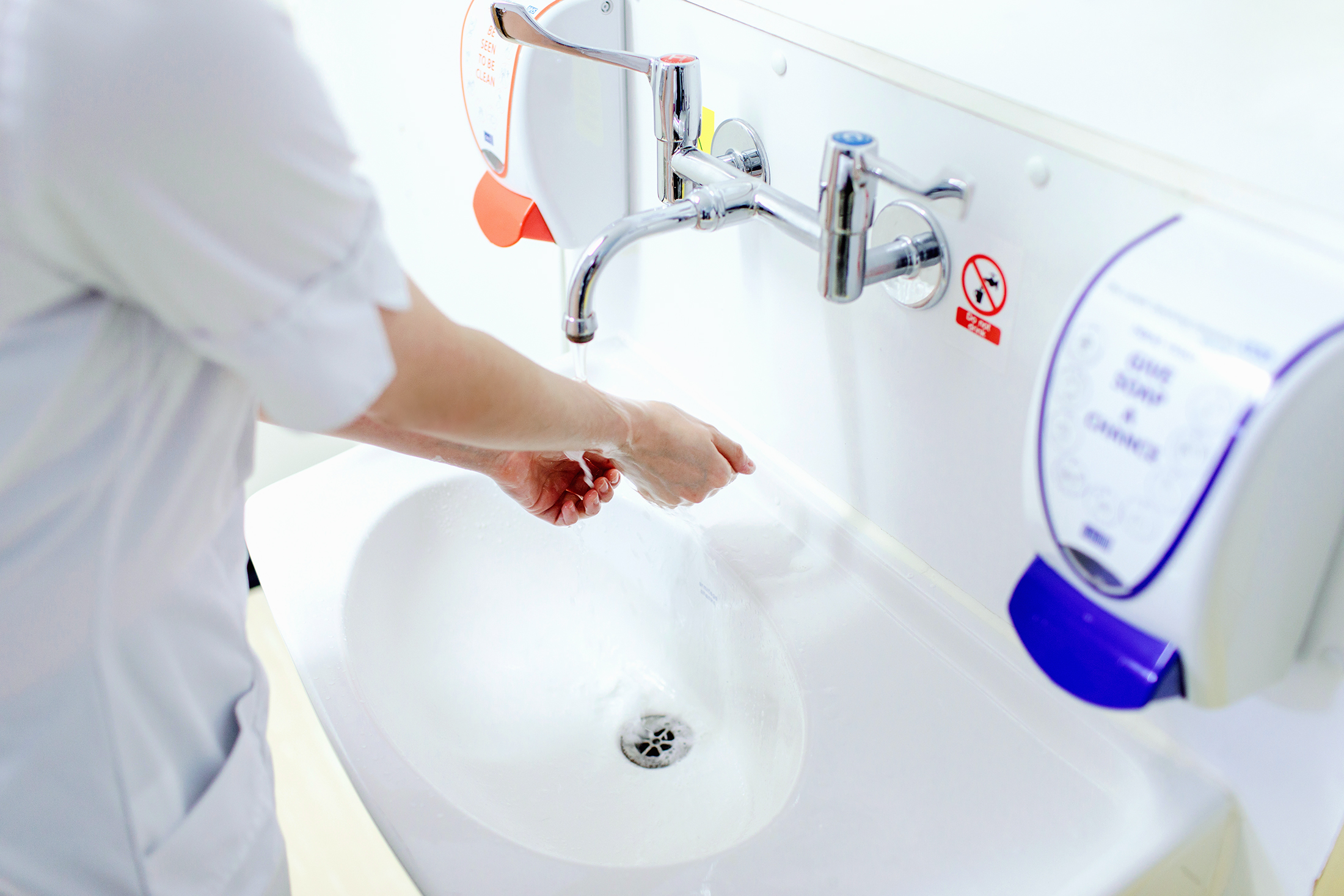 A student nurse washing her hands. Photograph by Mark Webster