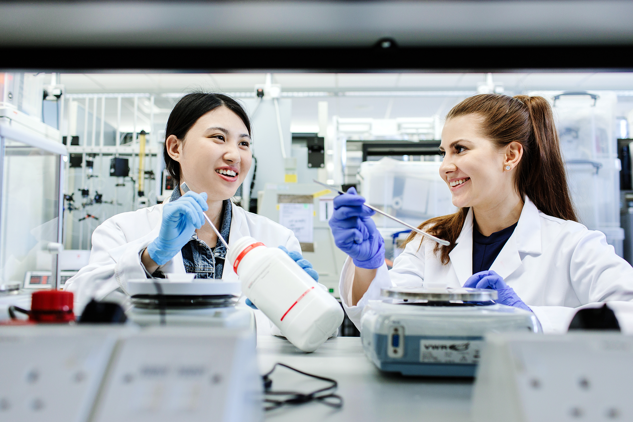 Two female postgraduate research students working in a lab at the University of Leeds.